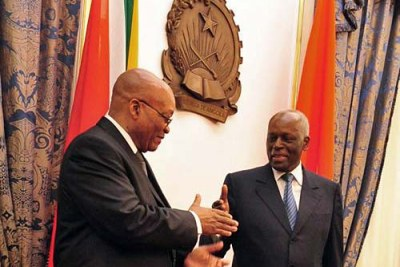 President Jacob Zuma of South Africa greets President José Eduardo dos Santos of Angola, during Zuma's first official state visit to a foreign country.