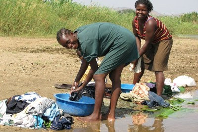 Women do laundry on the banks of the Rukuru River in Karonga district.