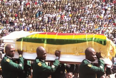 Pallbearers carry a casket at the National Heroes Acre (file photo).