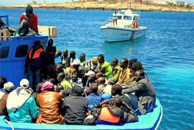 A boat carrying sub-Saharan African migrant workers arrives in Italy last year.