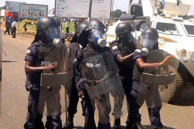 Riot police prevent protesters from entering a major Monrovia street (file photo).