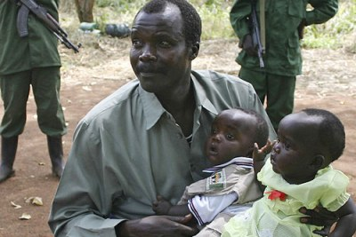 Joseph Kony holds his daughters at a past peace negotiation meet (file photo).