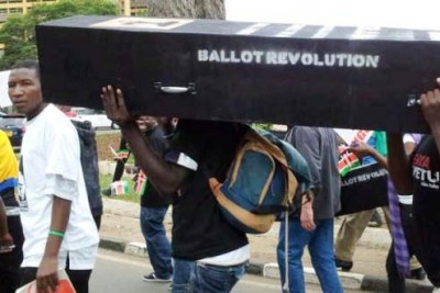 Protesters carrying a coffin symbolizing one of Kenya's many scandals.