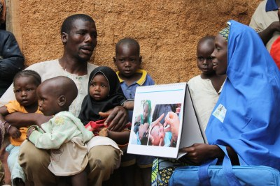 Binta, a Volunteer Community Mobilizer, has convinced Sabiu to get his children immunized against polio.