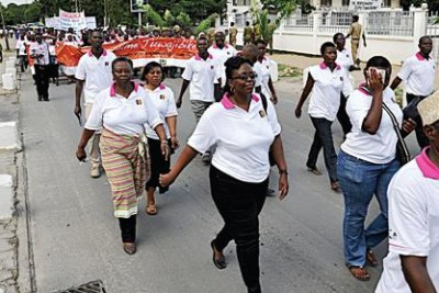 A section of members of the diplomatic community, activists and Dar es Salaam residents march during the launch of the 16 days of 'Scold Violence Against Gender'.