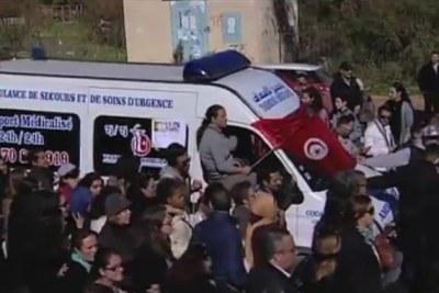 Supporters accompanied the ambulance carrying the body of Chokri Belaid, a vocal critic of the Islamist-led government who was shot in February.