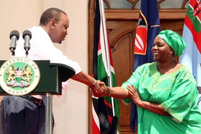President Kenyatta with Ambassador Raychelle Awour Omamo after being nominated for the post of Cabinet Secretary in the Ministry of Defence.
