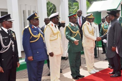 President Goodluck Jonathan (right) being received by service chiefs.