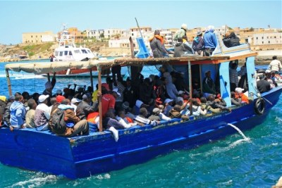 A boat carrying migrants arrives at the Lampedusa port, escorted by the coastguard (file photo).