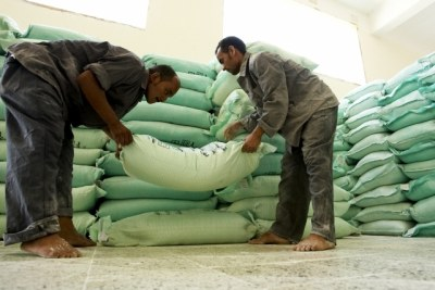Mill workers stack sacks of flour (file photo).