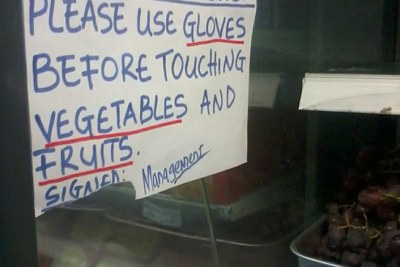 A sign at the fruit section of a grocery store urging customers to wear gloves, as Liberians worry about the spread of the deadly Ebola virus.