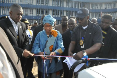 President Sirleaf and Director of Police, Clarence Massaquoi(file photo)