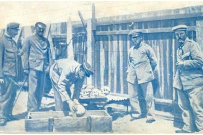 German soldiers loading skulls and bones of massacred Herero into a casket for shipping to Germany.