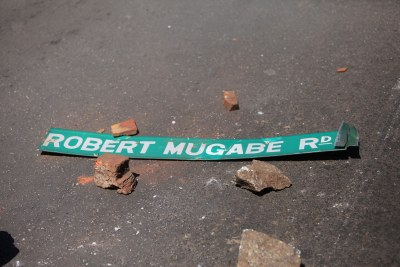 Vandalized Robert Mugabe street road sign.