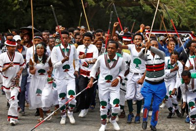 Demonstrators chant slogans while flashing the Oromo protest gesture during Irreecha, the thanksgiving festival of the Oromo people, in Bishoftu town, Oromia region, Ethiopia.