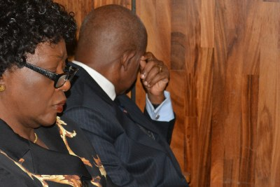 Justice Adeniyi Ademola (right) looks away from the camera while appearing before an Abuja High Court. He and his wife, Omobolanle (left) were granted bail. (file photo).