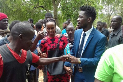 Bobi Wine greets locals in Gayaza, Kasangati recently.