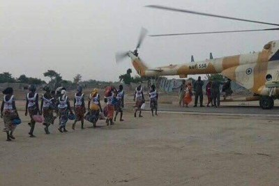 Chibok schoolgirls get on helicopter..