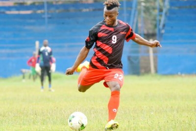 Harambee Stars winger Ayub Timbe shoots the ball during their training session at Kenyatta Stadium.