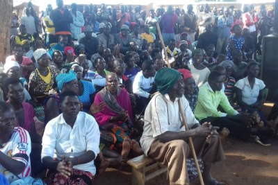 Residents of Apaa Trading Centre in Zoka Village, Amuru District attend a meeting.