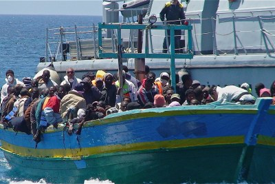 Refugees land at Lampedusa island in Italy.