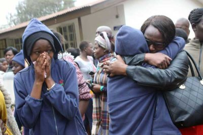 Parents and students of Moi Girls School Nairobi overcome by grief after a fire that claimed the lives of nine students.
