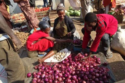 Meres Abe, an Ethiopian businesswoman and her children sells at the Moyale open air market.