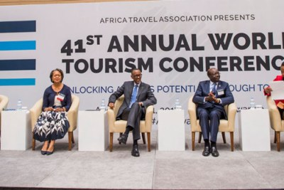 Paul Kagame (Middle) with Africa and World tourism officials in Kigali.
