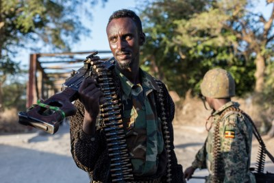 Somali soldier with Ugandan AMISOM troops.