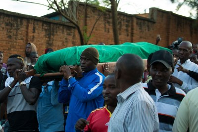 Rayon Sports players, including Ismailla Diarra (left) and Tidiane Kone (right), carry the body of the Blues' former assistant coach Hamadi Katauti Ndikumana from his home in Nyakabanda to Qaddafi mosque in Nyamirambo.