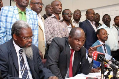 Universities Academic Staff Union (Uasu) chairman Mugo Kolale (left), Secretary-General Constantine Wasonga and other union members during a press conference at Meridian Hotel in Nairobi.