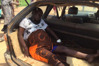 Jamila Faidah in the boot of a Toyota G-Touring before being transported to Adjumani Hospital to deliver.
