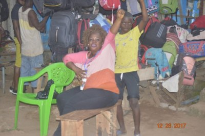 A CDC supporter shows her joy at George Weah's victory in Liberia.