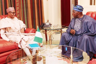 President Buhari in a meeting with Obasanjo.