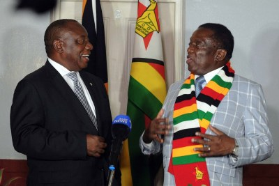 President Cyril Ramaphosa of South Africa and President Emmerson Mnangagwa of Zimbabwe meet in Harare on March 17, 2018.