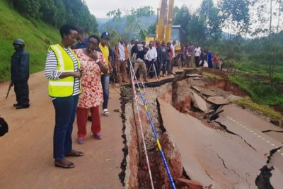 Uganda roads agency executive director Allen Kagina  and team visit the damaged section of the Kabale- Katuna road.
