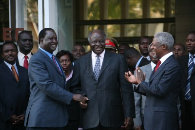 President of Kenya, Mwai Kibaki, shakes hands with opposition leader Raila Odinga during peace talks in Nairobi, Kenya, January 2008. Peace talks have been ongoing, led by former UN Secretary-General Kofi Annan.