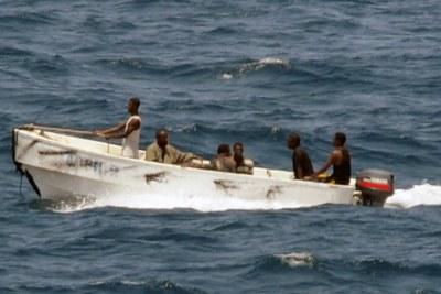 Pirates transiting from MV Faina to shore.