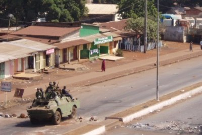 Armed soldiers crush protests in Guinea in February 2007.