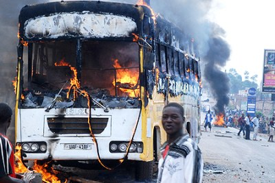 A bus goes up in flames in Kampala.