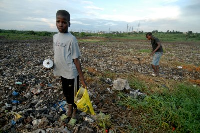 Two boys scavenge at dumpsite in Abidjan. Residents have complained of symptoms they feared were linked to the 2006 dumping of toxic waste.