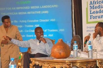 Trevor Ncube, longtime media entrepreneur in Zimbabwe and publisher of the Mail & Guardian in Johannesburg, makes a point at the Media Forum in Lagos, with Eric Chinje (left) of the World Bank and Amadou Mahtar Ba (right), President of AllAfrica Global Media and Forum co-covener, looking on.