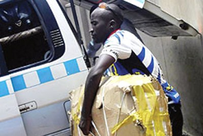 A Ugandan cyclists loads his bike for the Commonwealth Games.