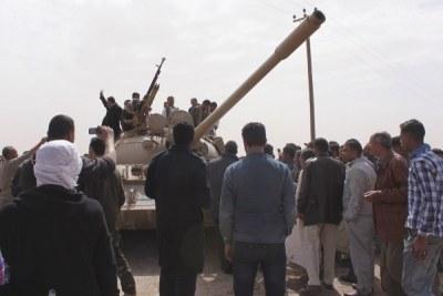 Forces opposed to Muammar al-Gaddafi.