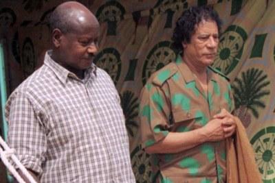 Ugandan President Yoweri Museveni (L) and Libya's Muammar al-Gaddafi.