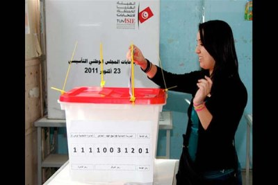 A voter casting her ballot.