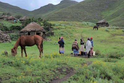 Women collect water from a communal tap in the village of Ha Rantismane in Lesotho's mountainous Thaba-Tseka District.