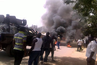 Smoke billows from the protest that followed yesterday's bomb attack at St Finbarr's Parish Rayfield, a Catholic church in Jos.