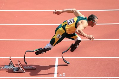 South Africa's Oscar Pistorius made history when he joined the men's 400m heats as the first amputee to take part in an Olympics track event.