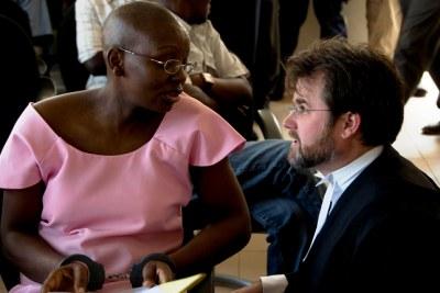 Rwandan opposition politician Victoire Ingabire speaks with her lawyer.